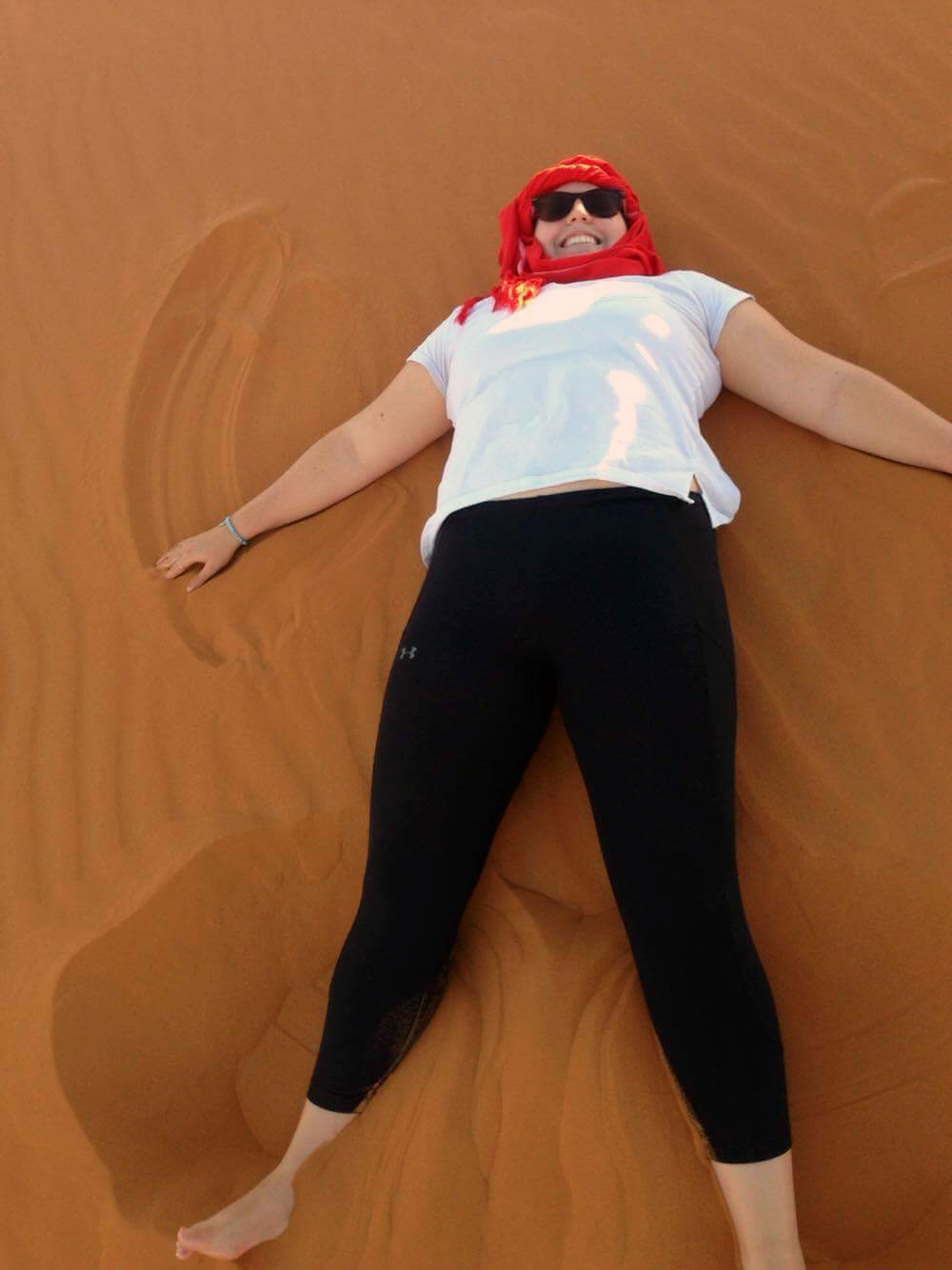 The author poses as a sand angel